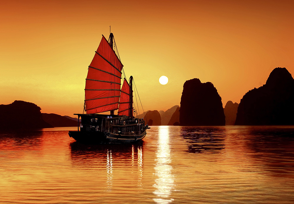 Junk in the sea of Halong Bay, a UNESCO World Natural Heritage Site, Karst mountains, romantic sunset, image composition, Vietnam, Asia